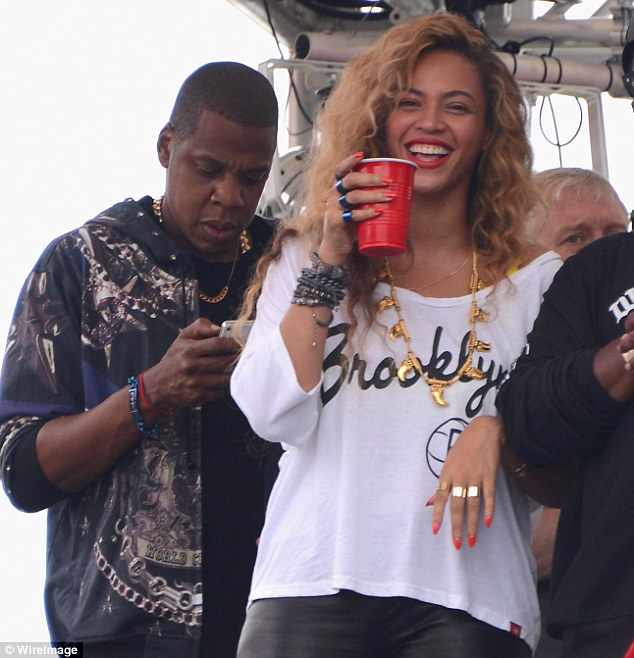 I'll drink to that: Jay-Z and Beyonce were seen relaxing with a beer backstage at the Budweiser Made In America Festival