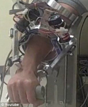 Mechanical marvel: The arm will eventually cover the entire arm - from elbow to fingertip - to help aid movement