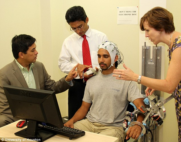 A University of Houston (UH) graduate student tests MAHI-EXO II, the robotic rehabilitation device which aims to help spinal-cord-injury patients recover