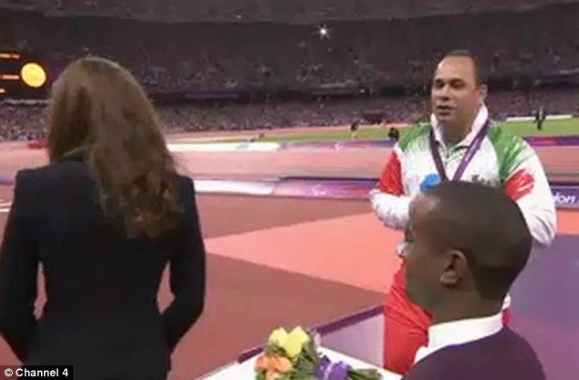 End of the presentation: The Duchess of Cambridge moves away from the athlete