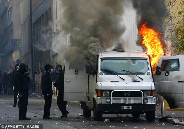 Contingency plans: Banks are discussing driving trucks full of cash into Greece to help facilitate the transition if it were to happen, though the exact model of car is unknown. Protestors shown here in 2008 attacked this bank transfer armored truck