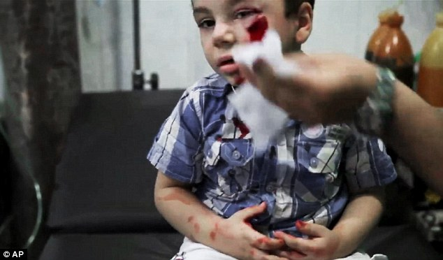 Upsetting: These pictures show wounded children being treated at the Dar al-Shifa hospital following a deadly attack by government forces
