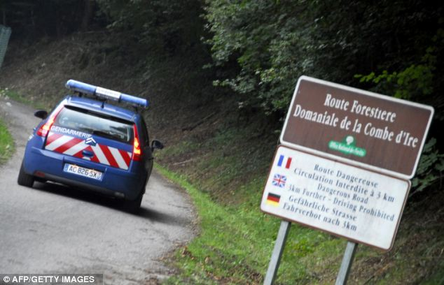 Grim: Three of the corpses - two women and a man - were in a car parked in a forest lay-by in hills next to Lake Annecy, in France¿s Haute-Savoie region