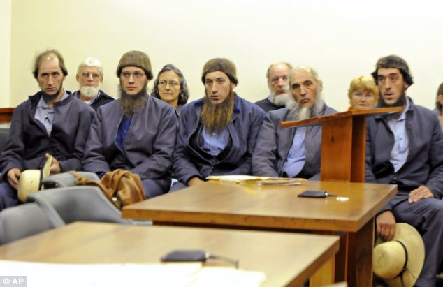 On trial: Miller (second right) sits next to, from left, Johnny Mullet, Lester Mullet, Daniel Mullet and his son Eli Miller in court in Millersburg, Ohio last year. They are all charged with teh hate crimes