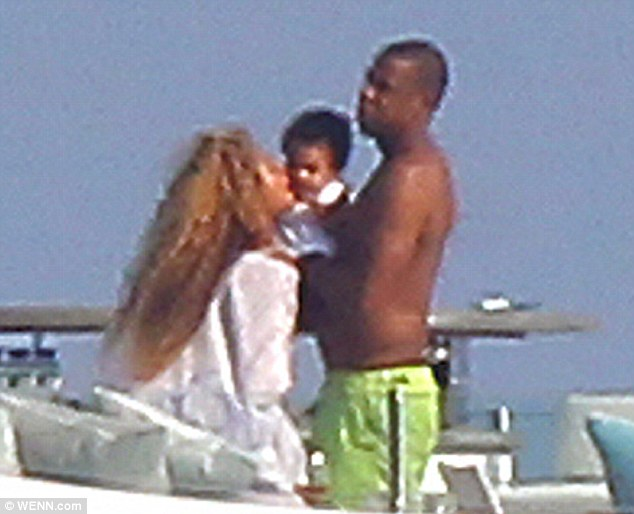 Mama loves you: Beyonce appeared to be reaching in for a kiss on Blue's cheek
