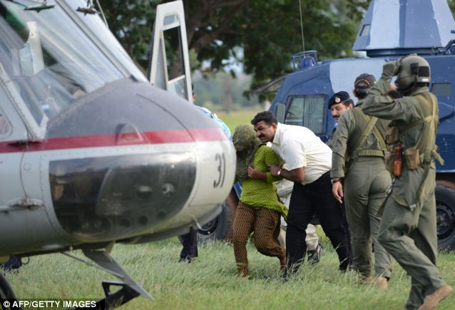 Pakistani security personnel shift Rimsha Masih to a helicopter after her release from jail in Rawalpindi