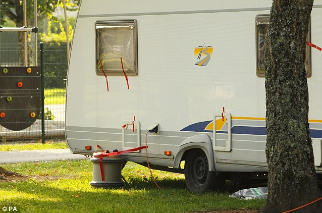Police tape seals the caravan and tent used by Saad al-Hilli and his family while on holiday at the Le Solitaire du Lac campsite on Lake Annecy in the Haute-Savoie region of south-eastern France