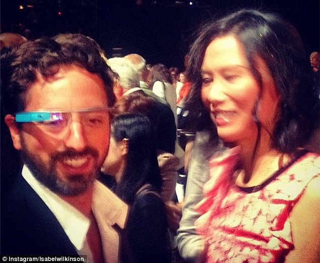 Showing off: Google founder Sergey Brin was pictured wearing the device while talking to Rupert Murdoch