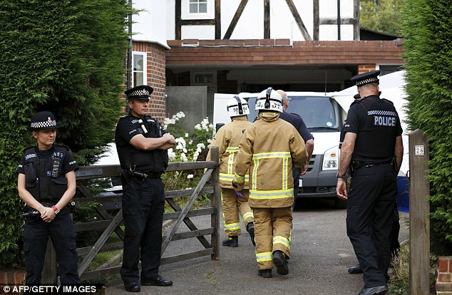 British firefighters arrive at the British home of a family shot dead in their car in the French Alps, in Claygate