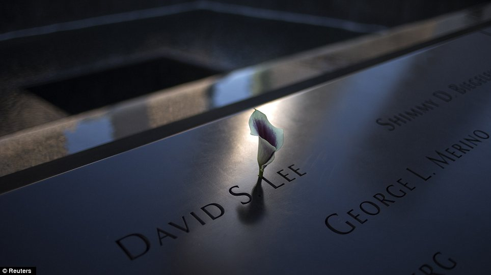 Grief: A single flower inserted into one of the names on the 9/11 National Memorial located at Ground Zero