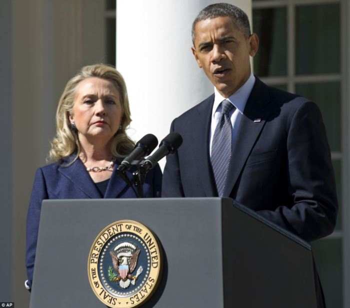 Condemnation: President Obama, joined by Hillary Clinton, speaks in reaction to the killing of the US Ambassador to Libya on Wednesday morning
