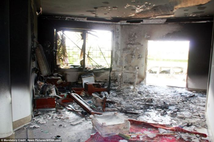 Burnt out: The U.S. consulate in the Libyan city of Benghazi - it has also been revealed today that the Benghazi consulate was not protected by the contingent of Marines that usually safeguard embassies