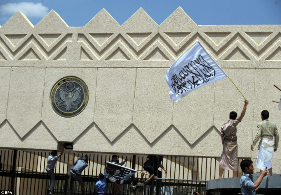 Clashing sides: The furious activists storming the embassy in the Yemeni capital were fired at by security forces, according to local media reports