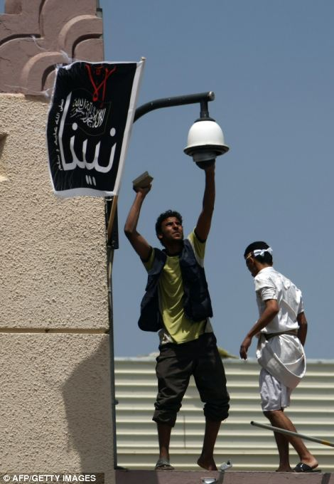 Yemeni protesters try to break the security camera