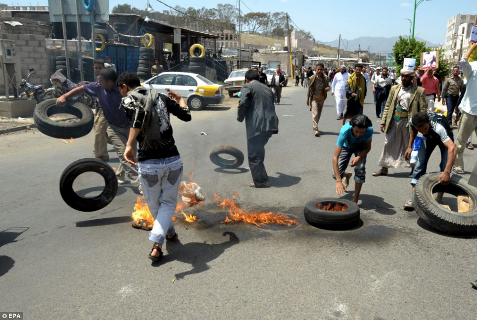 Fighting with fire: Protesters burn tyres - the violence has raised worries that further protests could break out around the Muslim world as anger spreads over the film