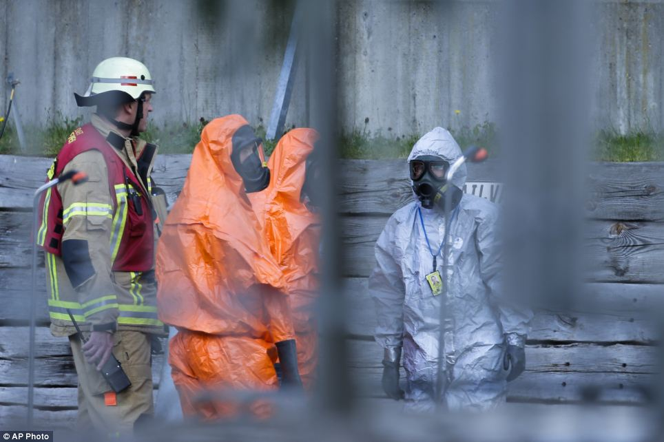 Precaution: Firefighters in protective clothing arrived at the U.S. consulate in Berlin, Germany, today after staff reported a strange smell coming from an envelope sent to the building - three employees who handled the documents inside became unwell