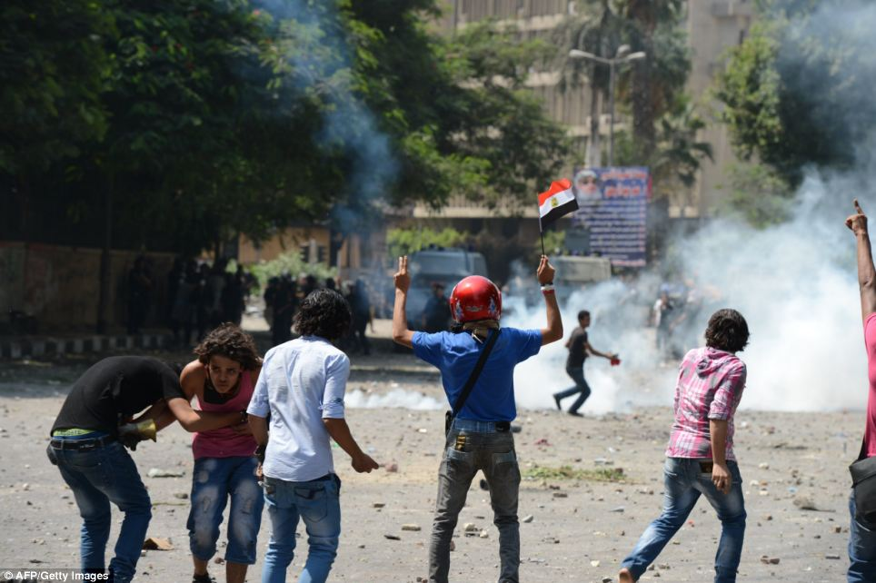 Clash: Police used tear gas to try and disperse protestors close to the U.S. embassy in Cairo, Egypt, today
