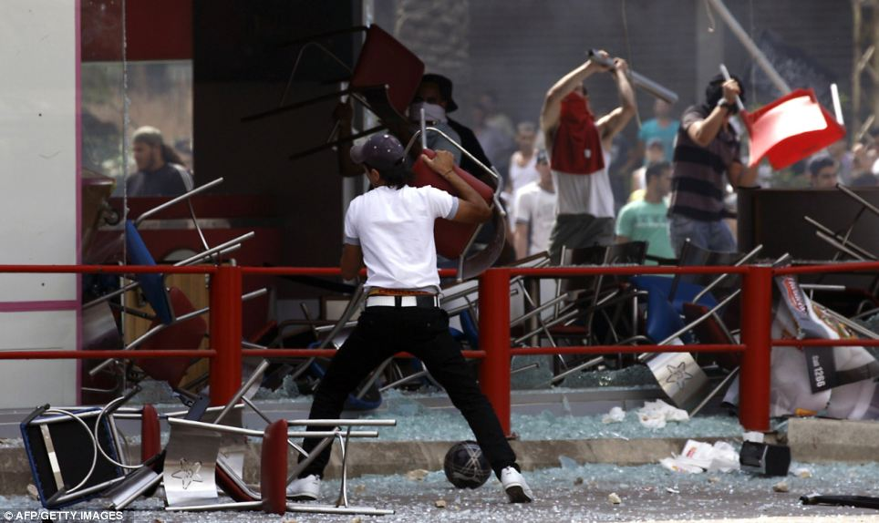 Smash and burn: In Lebanon, one demonstrator was killed and dozens wounded as they tried to storm a government building