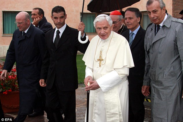 In transit: The Pope was accompanied by officials as he started his journey to Lebanon from Rome's Ciampino Airport