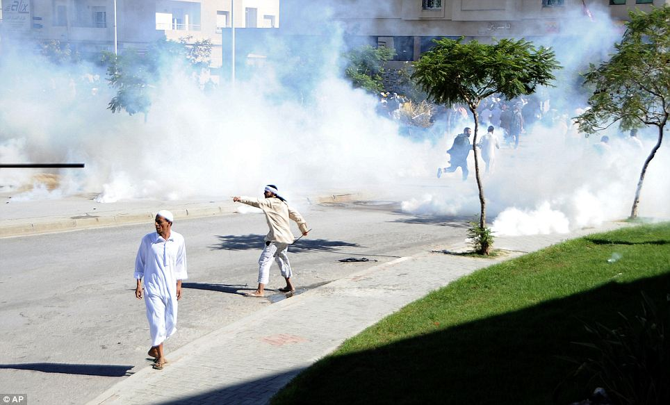 Anger spreads: Demonstrators protest outside the US embassy in Tunisia today