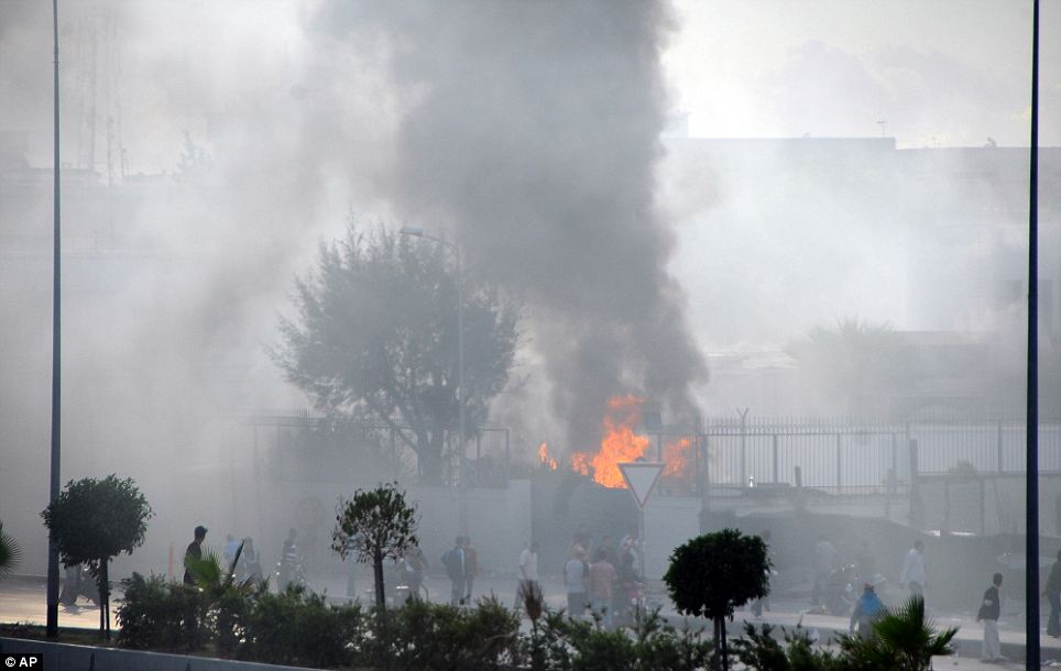 The American school adjacent to the U.S. embassy compound burns during clashes in Tunis