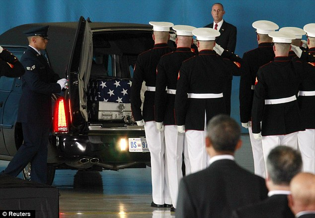 U.S. President Barack Obama watches as the body of an American killed in Benghazi this week is placed in a hearse during a 'Return of Remains' ceremony at Andrews Air Force Base