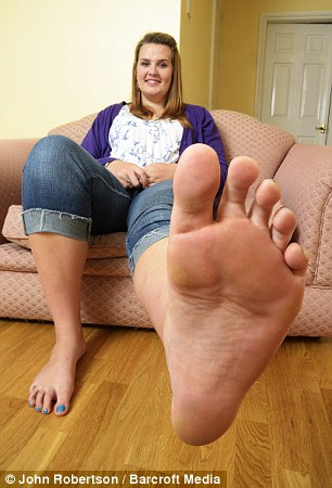 Emma Cahill, 19, with her size 14 feet in Worcester, England