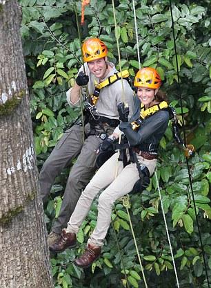 Smiling: The Duke and Duchess of Cambridge venture into the jungle in Borneo