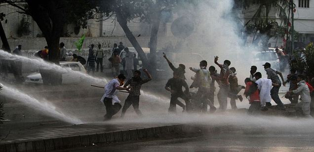 Pakistani police use a water cannon to disperse the protesters marching toward the U.S. consulate during a demonstration in Karachi, Pakistan