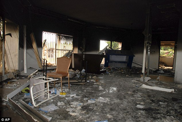 Bloody sacking: Glass, debris and overturned furniture are strewn inside a room in the gutted U.S. consulate in Benghazi after the attack that killed four Americans