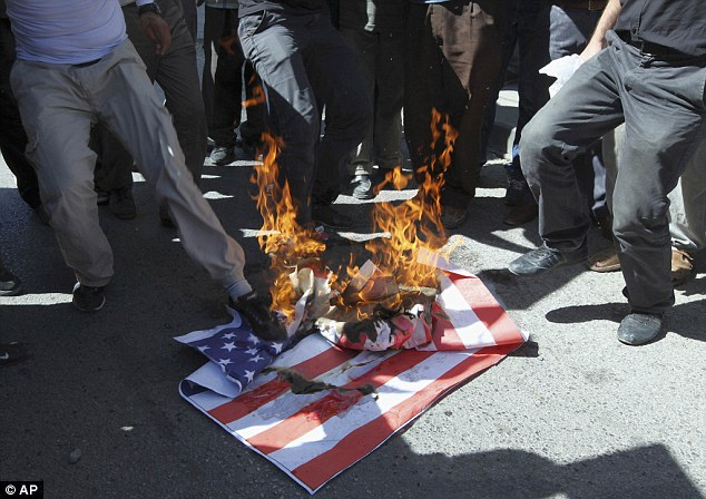Threatening gesture: A mock U.S. flag set on fire by a group of about 50 angry Islamists, who were shouting anti-U.S. slogans and protesting against a film ridiculing the Prophet Muhammad, near the U.S. embassy in Ankara, Turkey