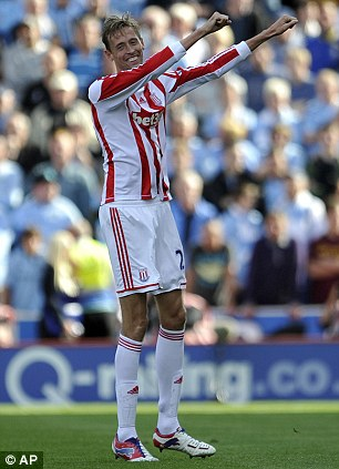 Stoke City's Peter Crouch celebrates after he scored the first goal of the game for his side