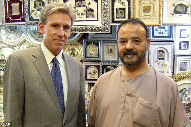 Ambassador: Chris Stevens, left, was believed to have been alive as he was pulled out of a room in the consulate hours after the attack