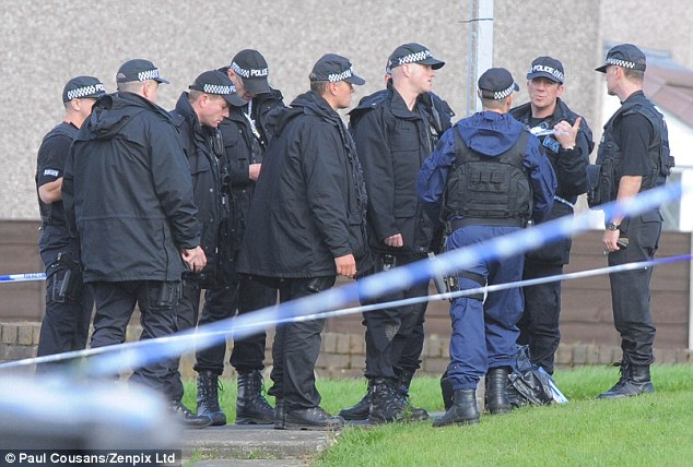 Follow-up probe: Armed police gather on the estate in after two of their colleagues were killed