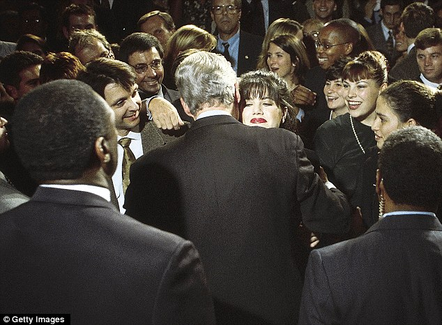 Centre of a scandal: In October 1996, Clinton embraces Lewinsky, then a White House intern
