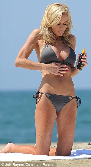 Safety first: The reality star was seen rubbing suncream on protecting her skin from the harsh rays