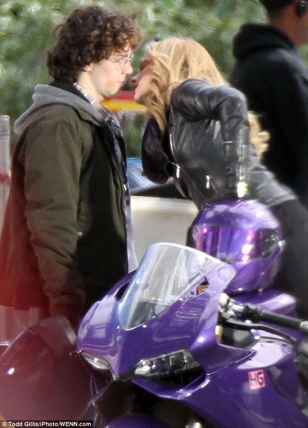 On screen romance: Chloe Moretz and Aaron Taylor-Johnson share a kiss while filming scenes in Toronto for Kick-Ass 2 on Wednesday