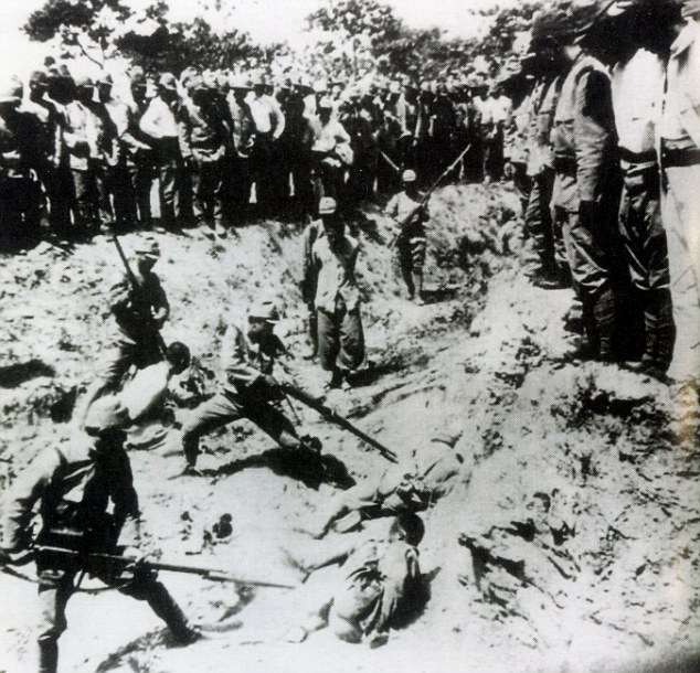 Massacre: Japanese soldiers bayonet Chinese prisoners in Nanking