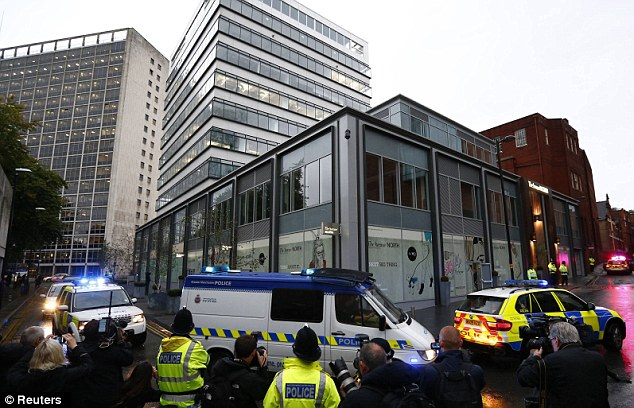 Crowd: Cregan was rushed into Manchester Magistrates' Court in this van (centre) morning sandwiched by a fleet of six police vehicles