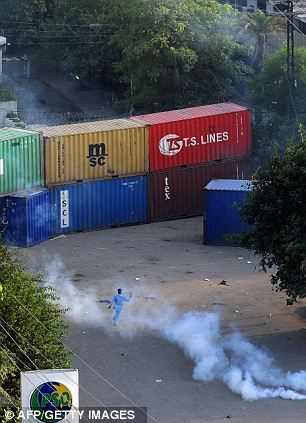 Deterrents: Stacked freight containers and tear gas were used to keep demonstrators away in Lahore