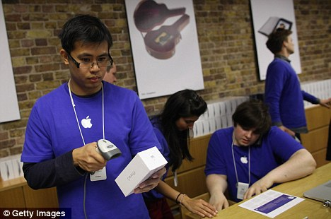 Anticipation: Apple workers in Covent Garden sell the first few iPhone 5s this morning as the hotly-anticipated device goes on sale