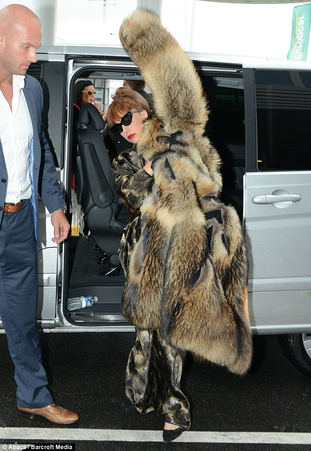 Lady Gaga Steps Out In Fur Outfit As She Tries To Cover Up
