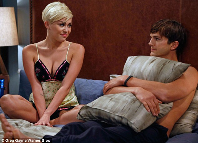 New couple alert! A lingerie-clad Miley Cyrus beds Ashton Kutcher in her upcoming cameo in Two And A Half Men