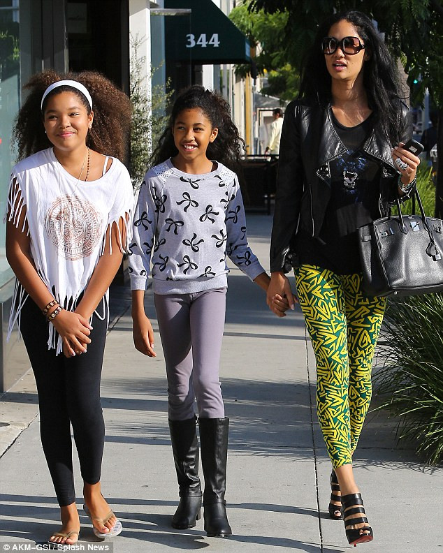 Window shopping only! Kimora Lee Simmons took her daughters Ming Lee, 12, and Aoki Lee, 10, window shopping in the upscale neighbourhood of Beverly Hills on Wednesday