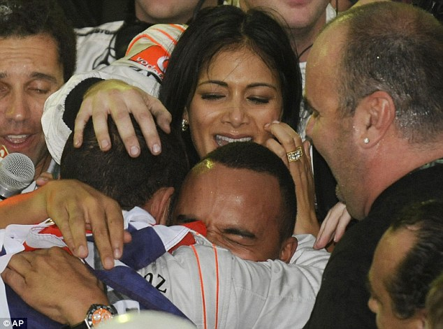 Champion: Lewis Hamilton embraces his brother Nicholas, centre and Nicole when he won the Formula One world drivers' championship in 2008
