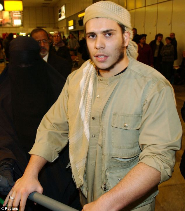 Mohammed Mustafa Kamel arrives at London Heathrow airport in 2002 after his three year prison term on terrorism charges in the Yemen city of Aden