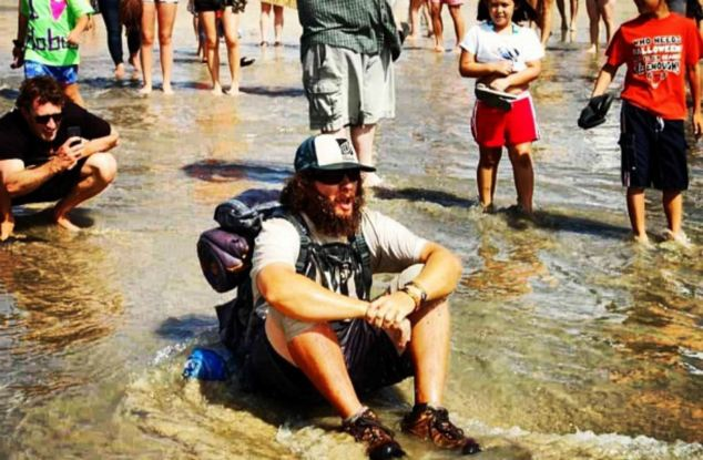 Finally: Mr Kleckner's parents were there to meet him at the end and he was pictured with his toes in the Pacific Ocean