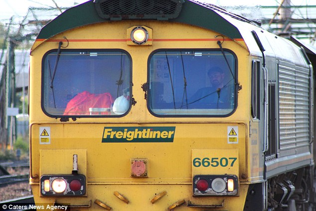 Dozing off? Photographer Stuart Littleford took the picture of the bearded driver, who appears to be fast asleep in the cab of the Class 66 locomotive at Doncaster station in South Yorkshire on September 11