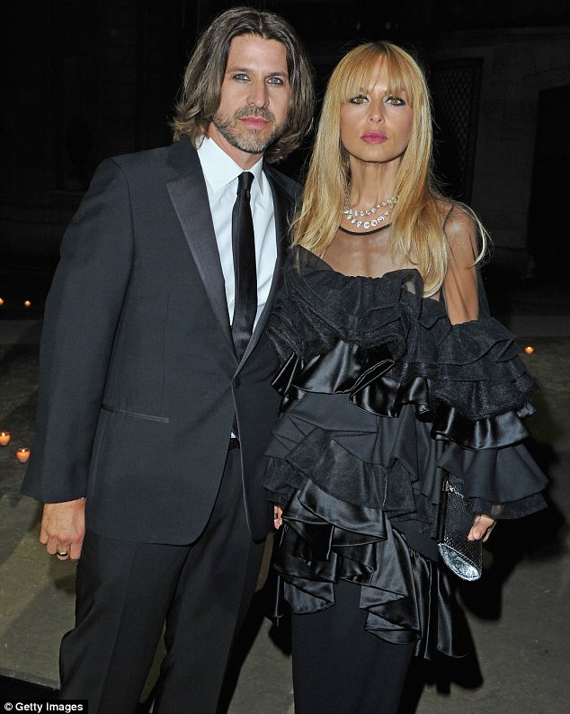 In touch with his feminine side: Rachel Zoe's husband Rodger Berman was wearing lashings of eyeliner for a MAC event at Paris Fashion Week on Tuesday