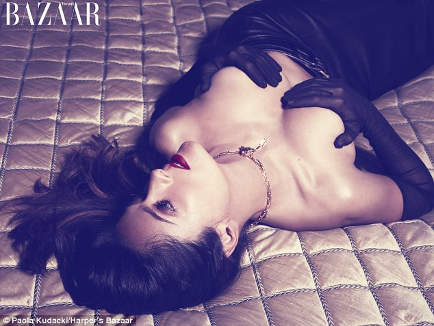 Racy: In one shot for the magazine Salma is seen covering her breast with gloved hands